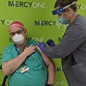 Photo of MercyOne Physician Receiving COVID Vaccination