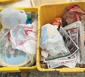 Plastic bags are NOT allowed in curbside recycling