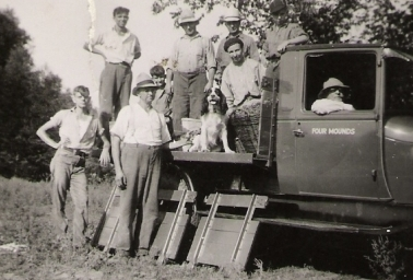 Men Standing Around A Truck