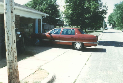 Car over sidewalk