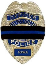 Dubuque badge with mourning band.